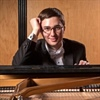 Pianist Adam Swanson profiled for accomplishments