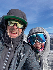 Stephen Sullivan and one of his kids in the mountains.
