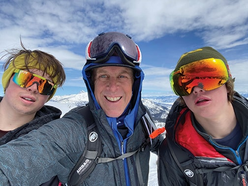 Stephen Sullivan and two of his kids in the mountains.