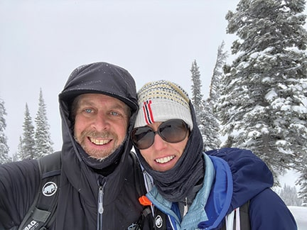 Stephen Sullivan and his wife smiling in the snowy mountains