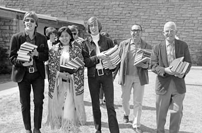 1960s students and faculty carrying books