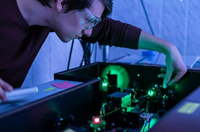 Physicist working with lasers in a lab