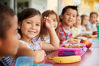 Kids eating healthy lunch meals