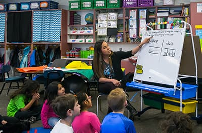 FLC student teaching young children in a classroom