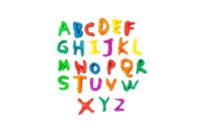The English alphabet spelled out in paint on a white background