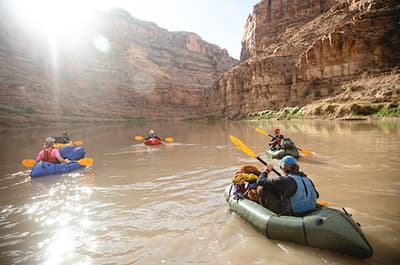 Students in inflatable kayaks on a Southwest river with Outdoor Pursuits