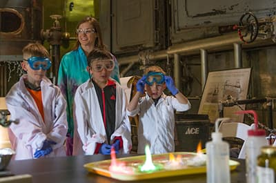 FLC Chemistry majors and faculty teaching science to children in a chemical demonstration in partnership with the Powerhouse Science Center
