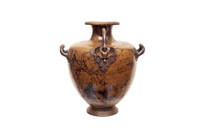 Ancient urn against a white background