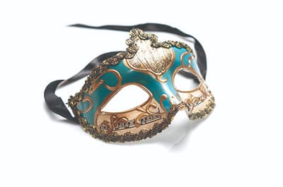 Fancy theatrical mask against a white background