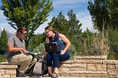 FLC students working academically outside on campus