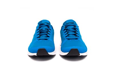 Blue running sneakers against a white background representing our Exercise Science minor