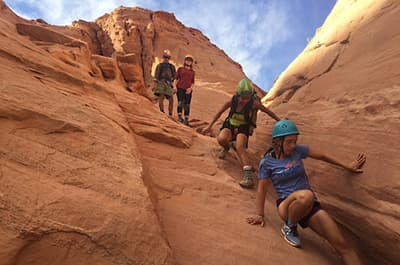 Adventure Ed students descending a canyon wall