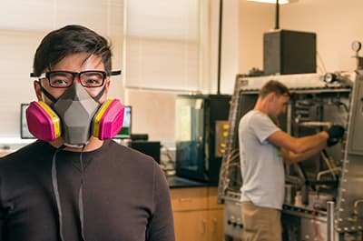 FLC engineering student with respirator mask on in the lab