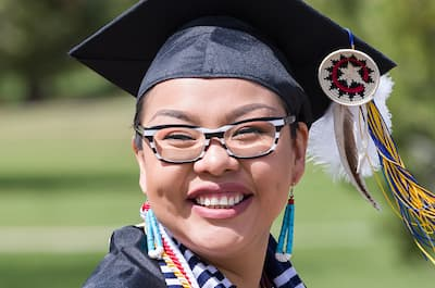 Native American student at graduation, representing what awaits transfer students at Fort Lewis College