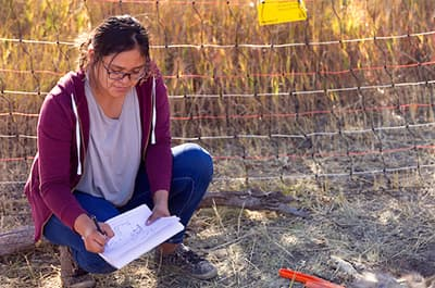Native student doing forensic biology fieldwork
