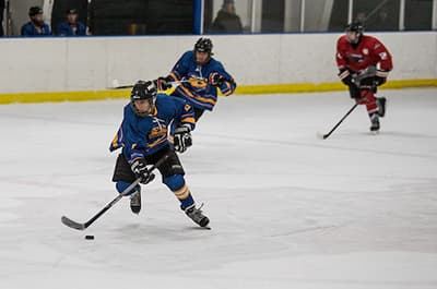 Fort Lewis College ice hockey players playing against their opponent