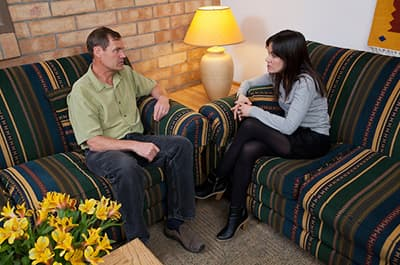 Counseling Center staff in discussion on two couches