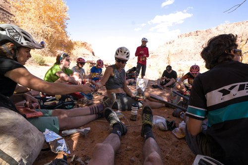 Durango devo cyclists take a break in the shade during a pack rafting trip.