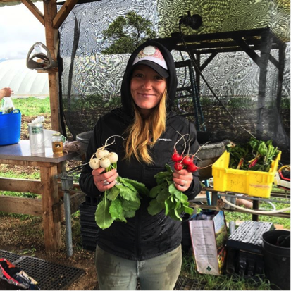 Emily Adie, assisting with farm operations