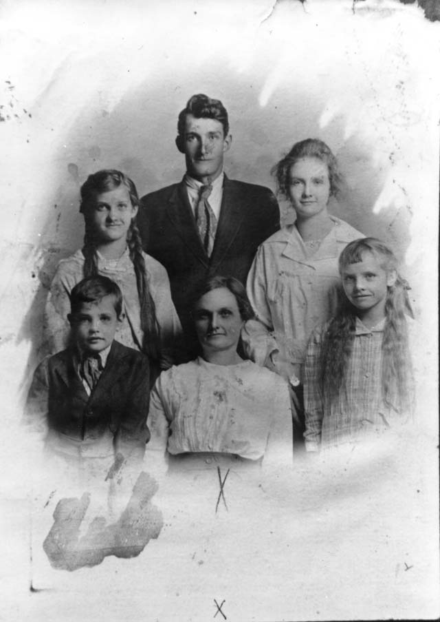 Frank Moss and his siblings and mother