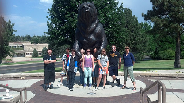 Upward bound Students in front of UNC Bear